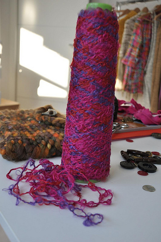 In the foreground a beautiful vintage yarn next to the pochette knit with The Giant.